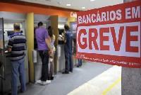 Bancos p�blicos e privados entram em greve